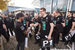 Lewis Hamilton greets Mercedes factory workers