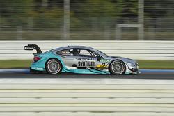 梅赛德斯AMG马石油车队驾驶梅塞德斯AMG C-Coupé的丹尼尔·朱尼卡德拉
