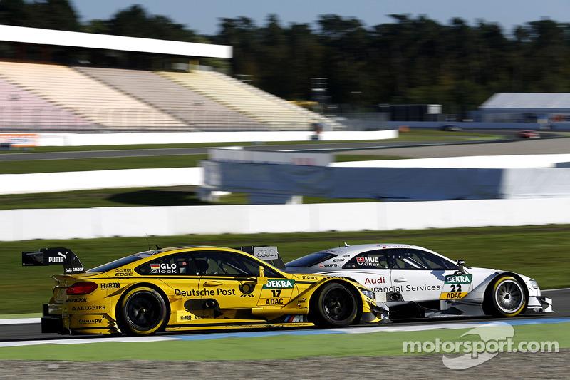 Timo Glock, BMW Team MTEK BMW M3 DTM y Nico Muller, Audi Sport Team Rosberg Audi RS 5 DTM