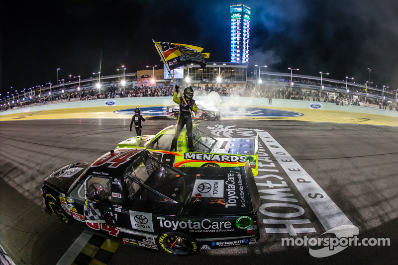 NASCAR Camping World Truck Series 2014 champion Matt Crafton celebrates with race winner Darrell Wallace Jr. and Kyle Busch