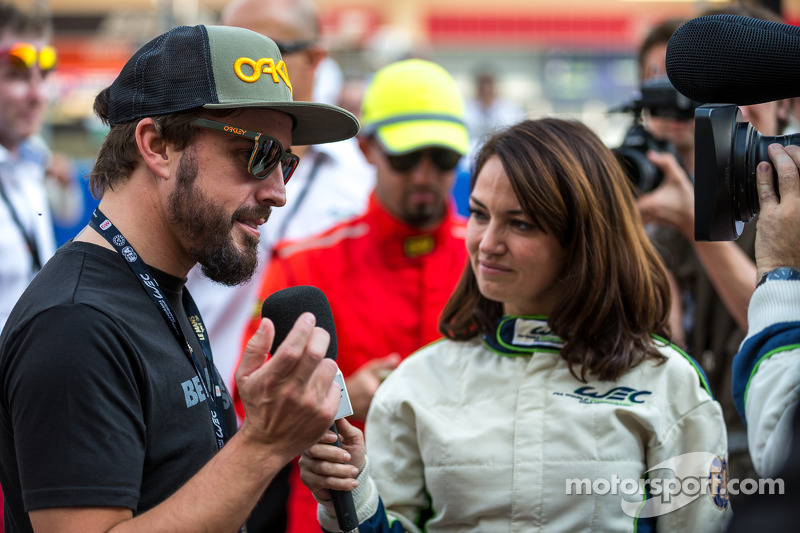 Fernando Alonso being interviewed on the grid