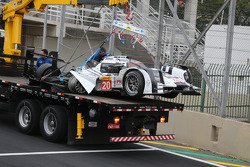 The Porsche 919 Hybrid of Mark Webber is taken away after a major crash with Matteo Cressoni