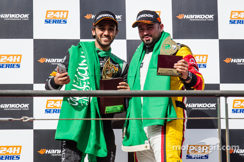 General podium: race winner Abdulaziz Al Faisal celebrates with Mohammed Jawa