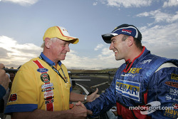 Australian V8 Supercar Series 2004 champion Marcos Ambrose celebrates with Dick Johnson, another back to back champion