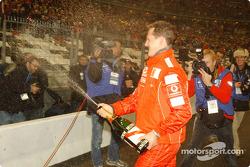 The World Champions Challenge 2004 winner Michael Schumacher sprays champagne