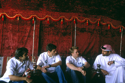 Antonio Pizzonia, Mark Webber and Nick Heidfeld relax in a tent