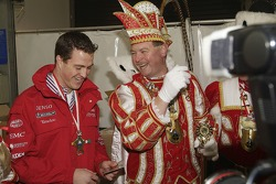 Ralf Schumacher shares a joke with the Cologne Carnival Prince