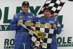 Victory lane: race winners Ian James and Tom Nastasi celebrate