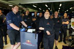 Red Bull Racing team members watch qualifying