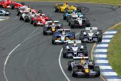 First corner action: David Coulthard leads the pack