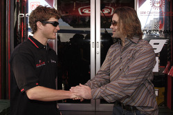 Kasey Kahne greets Scott Stapp formerly the lead singer for the band Creed