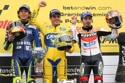 Podium: race winner Alex Barros with Valentino Rossi and Max Biaggi