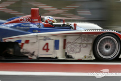 #4 Audi Playstation Oreca Audi R8: Jean-Marc Gounon, Stéphane Ortelli blasts out of the pitlane after refuelling
