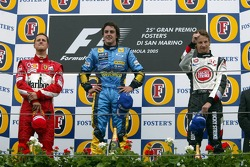 Podium: race winner Fernando Alonso with Michael Schumacher and Jenson Button