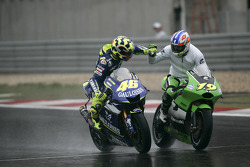 Race winner Valentino Rossi celebrates with Oliver Jacque
