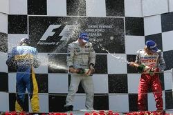 Podium: champagne for Kimi Raikkonen, Fernando Alonso and Jarno Trulli