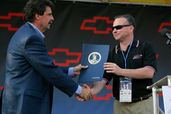 Virginia Lt. Governor Tim Kaine makes a presentation to NASCAR President Mike Helton prior to the NASCAR Nextel Cup Chevy American Revolution 400