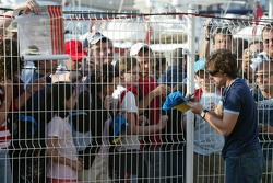 Fernando Alonso signs autographs