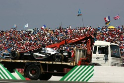 Car of Juan Pablo Montoya brought back to pits