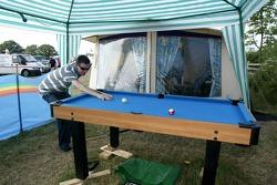 Camper plays pool