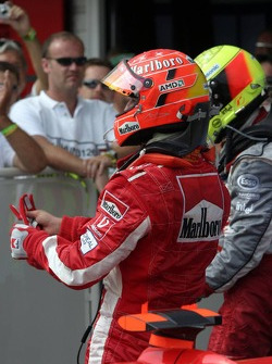Ralf Schumacher and Michael Schumacher celebrate podium finish