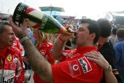 Ferrari team members enjoy champagne