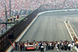 Race winner Tony Stewart is engulfed by media