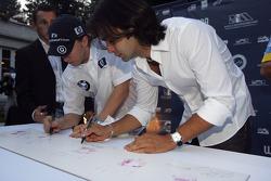 Antonio Pizzonia and Nick Heidfeld autograph their handprints