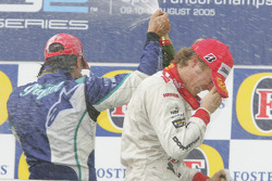 Podium: champagne for Nelson A. Piquet and Nico Rosberg