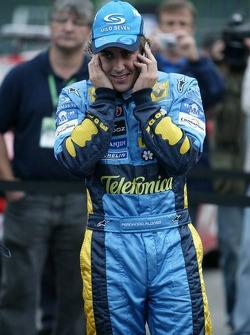 2005 World Champion Fernando Alonso phones home