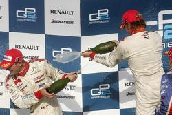Podium: champage for Nico Rosberg and Alex Premat