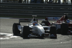 Nico Rosberg passes Ernesto Viso for the lead