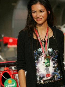 A lovely girl poses with the Ferrari
