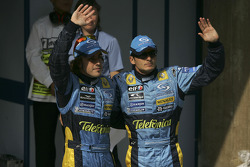Pole winner Fernando Alonso celebrates with Giancarlo Fisichella