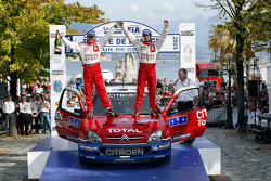 Podium: rally winners Sébastien Loeb and Daniel Elena celebrate