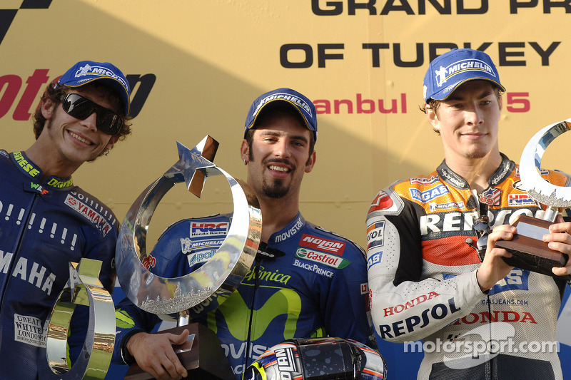 Podium: race winner Marco Melandri with Valentino Rossi and Nicky Hayden