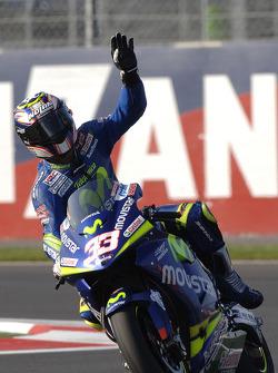 Race winner Marco Melandri celebrates