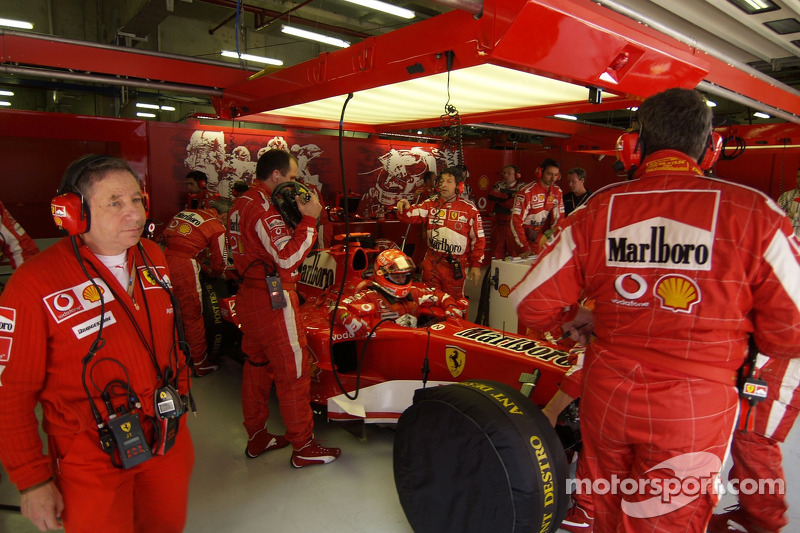 Michael Schumacher back in the garage after his crash