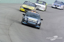 Field runs behind the Ford Fusion pace car