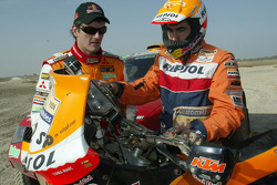 Marc Coma and Luc Alphand exchange machines at Lac Rose: Luc Alphand and Marc Coma