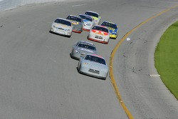 Mike Wallace leads a group of cars