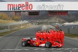 Michael Schumacher, Felipe Massa and Luca Badoer with Ferrari team members