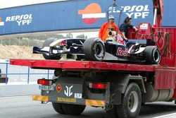 The new Torro Rosso STR1 of Vitantonio Liuzzi back in the pit after stopping on the track