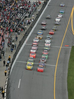 Jeff Gordon and Bobby Labonte lead the field to the green