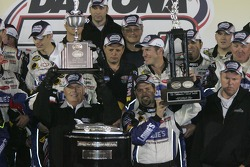 Victory lane: Rick Hendrick hoists trophy