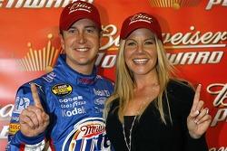 Pole winner Kurt Busch celebrates with fiancée Eva Bryan