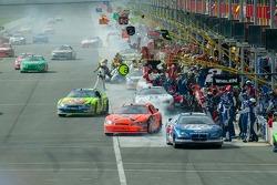 Race cars leaving pit lane after service