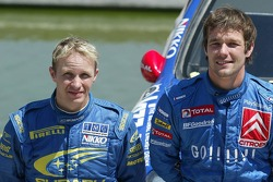 Podium: winner Sébastien Loeb with Petter Solberg