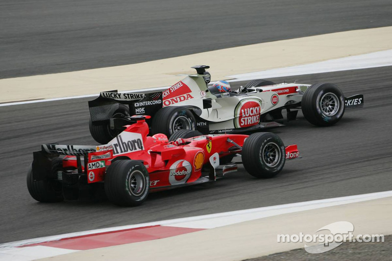 Jenson Button y Michael Schumacher