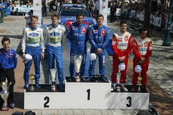 Podium: winners Sébastien Loeb and Daniel Elena, with second place Marcus Gronholm and Timo Rautiainen, and third place Daniel Sordo and Marc Marti